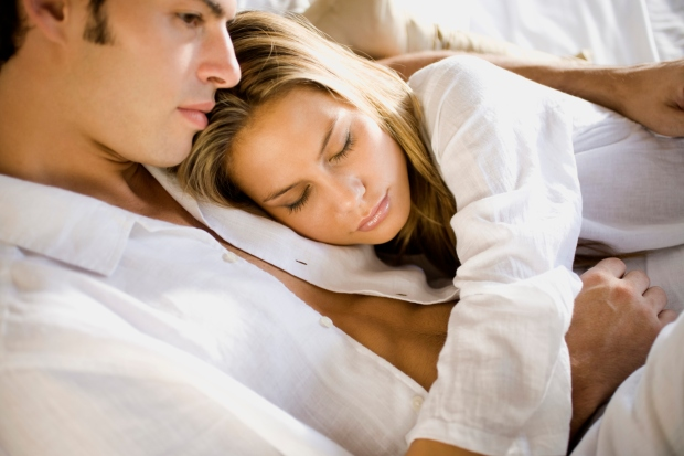 Couple lying down in bed
