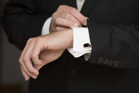 Well dressed man hands with elegant suit and accessories