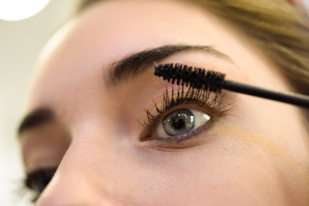 close-up-of-woman-applying-mascara-to-her-lashes_1139-194