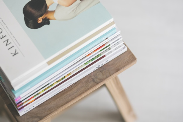 magazines-on-a-wooden-chair_1162-133