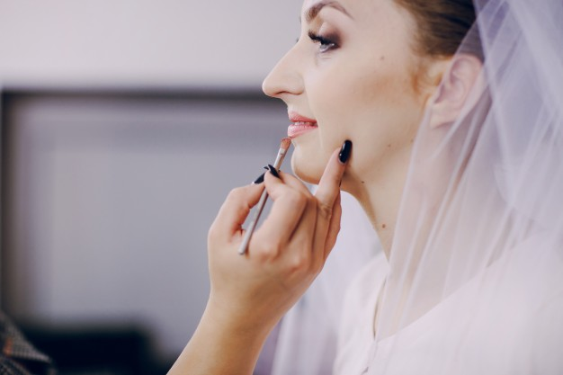 close-up-of-bride-preparing-for-her-day_1157-493