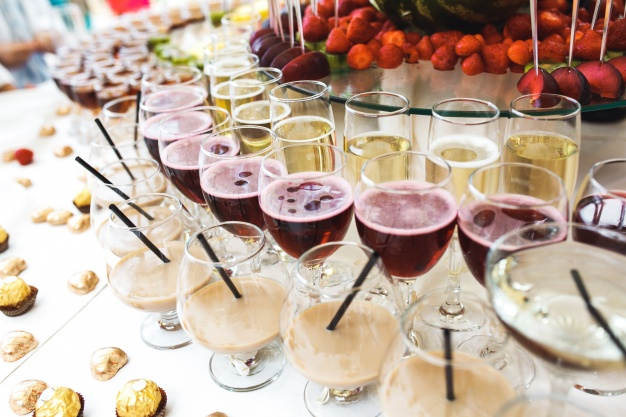 table-with-alcoholic-beverages-and-chocolates_1153-1557