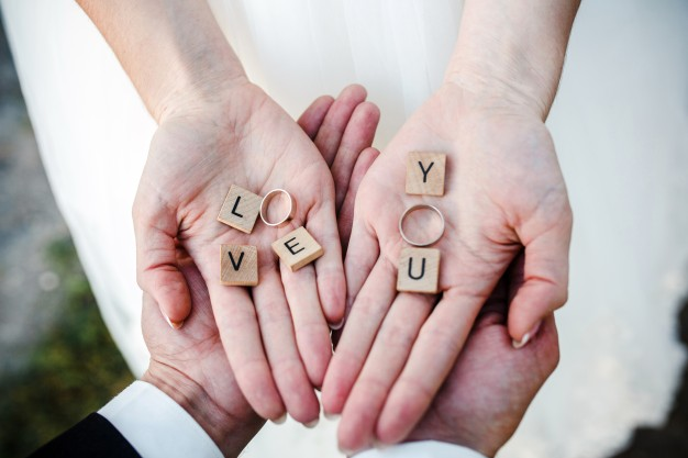 top-view-of-bride-s-hands-with-the-wedding-rings_1153-597-2