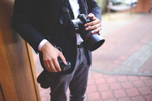 man-hands-photographer-cameras